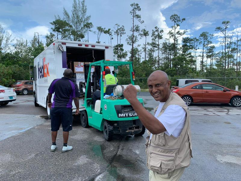 IHP Essential Health Packs are unloaded off a truck in the Bahamas