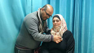 Patient receives a medical examination in Dura, Palestine