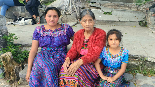 A Guatemalan family [mother, daughter and grandmother] sits for a photo
