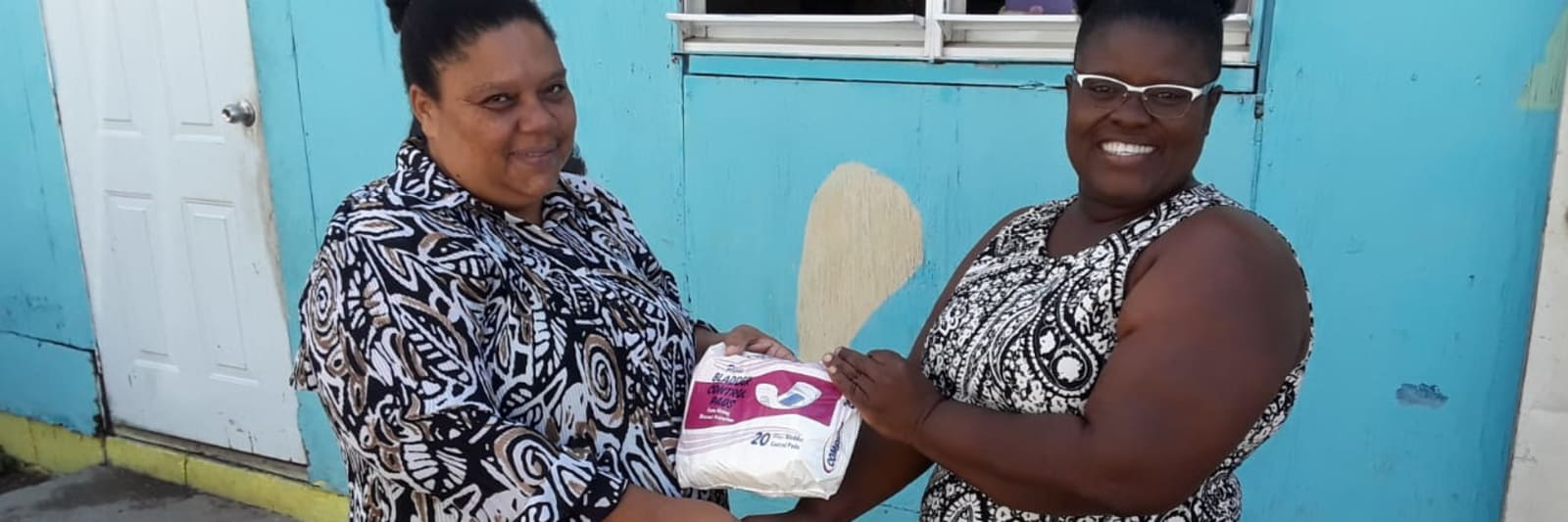Hospice residents happily receive the donation of pads